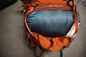 Kelty Sleeping Bag in Osprey Atmos 65 AG Backpack